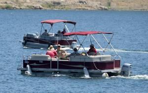 Members of the Ventura County Sheriff's Office used boats in the recovery operation (Ringo HW Chiu/AP)
