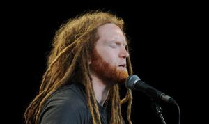 LONDON, UNITED KINGDOM - JUNE 12: Newton Faulkner performing at agit8 at Tate Modern, ONE's campaign ahead of the G8 on June 12, 2013 in London, England. (Photo by Stuart C. Wilson/Getty Images)