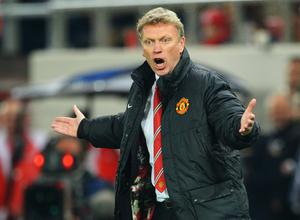 PIRAEUS, GREECE - FEBRUARY 25:  Manchester United manager David Moyes reacts on the touchline during the UEFA Champions League Round of 16 first leg match between Olympiacos FC and Manchester United at Karaiskakis Stadium on February 25, 2014 in Piraeus, Greece.  (Photo by Michael Regan/Getty Images)