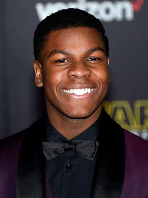 """HOLLYWOOD, CA - DECEMBER 14:  Actor John Boyega attends the premiere of Walt Disney Pictures and Lucasfilm's """"Star Wars: The Force Awakens"""" at the Dolby Theatre on December 14, 2015 in Hollywood, California.  (Photo by Ethan Miller/Getty Images)"""