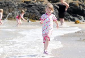 Northern Ireland- 10th July 2013 Mandatory Credit - Photo-Jonathan Porter/Presseye.    Good weather and sunshine continues across Northern Ireland as temperatures reach a 30-year- high.    Five-year-old Mia Totten from Bangor cools down in the sea at Groomsport beach in Co. Down.