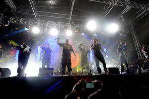 INDIO, CA - APRIL 14:  Wu-Tang Clan performs onstage during day 3 of the 2013 Coachella Valley Music & Arts Festival at the Empire Polo Club on April 14, 2013 in Indio, California  (Photo by Frazer Harrison/Getty Images for Coachella)