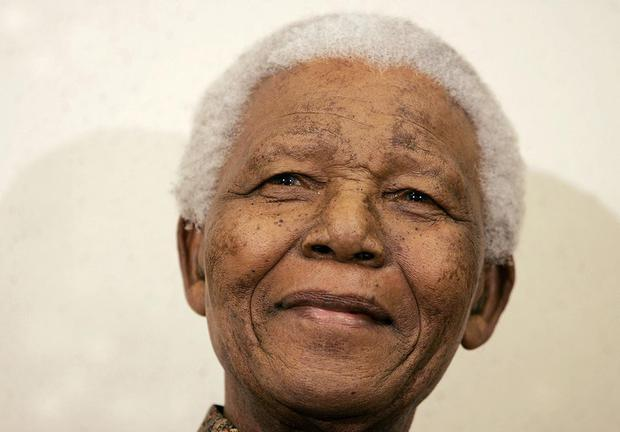 WASHINGTON - MAY 16: Former South African President Nelson Mandela smiles before speaking at the Brookings Intitution May 16, 2005 in Washington, D.C. Mandela talked about the role of the United States in development and aid efforts for Africa  (Photo by Mark Wilson/Getty Images)