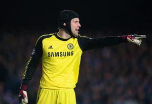 LONDON, ENGLAND - APRIL 08:  Petr Cech of Chelsea points during the UEFA Champions League Quarter Final second leg match between Chelsea and Paris Saint-Germain FC at Stamford Bridge on April 8, 2014 in London, England.  (Photo by Julian Finney/Getty Images)