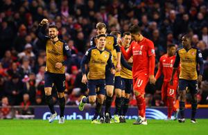 LIVERPOOL, ENGLAND - JANUARY 13: Olivier Giroud of Arsenal celebrates scoring his team's second goal  during the Barclays Premier League match between Liverpool and Arsenal at Anfield on January 13, 2016 in Liverpool, England.  (Photo by Alex Livesey/Getty Images)
