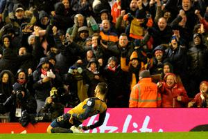 Arsenal's French striker Olivier Giroud celebrates after scoring his second goal during the English Premier League football match between Liverpool and Arsenal at Anfield stadium in Liverpool, north-west England on January 13, 2016. AFP PHOTO / PAUL ELLIS RESTRICTED TO EDITORIAL USE. NO USE WITH UNAUTHORIZED AUDIO, VIDEO, DATA, FIXTURE LISTS, CLUB/LEAGUE LOGOS OR 'LIVE' SERVICES. ONLINE IN-MATCH USE LIMITED TO 75 IMAGES, NO VIDEO EMULATION. NO USE IN BETTING, GAMES OR SINGLE CLUB/LEAGUE/PLAYER PUBLICATIONS.PAUL ELLIS/AFP/Getty Images