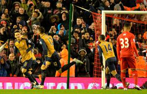 Arsenal's French striker Olivier Giroud (2L) celebrates after scoring his second goal during the English Premier League football match between Liverpool and Arsenal at Anfield stadium in Liverpool, north-west England on January 13, 2016. AFP PHOTO / PAUL ELLIS RESTRICTED TO EDITORIAL USE. NO USE WITH UNAUTHORIZED AUDIO, VIDEO, DATA, FIXTURE LISTS, CLUB/LEAGUE LOGOS OR 'LIVE' SERVICES. ONLINE IN-MATCH USE LIMITED TO 75 IMAGES, NO VIDEO EMULATION. NO USE IN BETTING, GAMES OR SINGLE CLUB/LEAGUE/PLAYER PUBLICATIONS.PAUL ELLIS/AFP/Getty Images