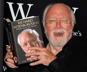 File photo dated 04/09/08 of Richard Attenborough with his autobiography, 'Entirely Up To You, Darling' as Lord Attenborough has died aged 90, the BBC reported tonight. PRESS ASSOCIATION Photo. Issue date: Sunday August 24, 2014. See PA story DEATH Attenborough. Photo credit should read: Fiona Hanson/PA Wire