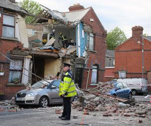 Emergency services at the scene in a suspected gas explosion on Sullivan Stree. Pic Niall Carson/PA Wire
