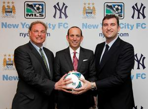 Undated handout photo provided by the MLS of New York Yankees' Randy Levine (left), MLS commissioner Don Garber (centre) and Manchester City chief executive Ferran Soriano during a photocall