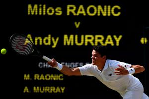 TOPSHOT - Canada's Milos Raonic returns to Britain's Andy Murray during the men's singles final match on the last day of the 2016 Wimbledon Championships at The All England Lawn Tennis Club in Wimbledon, southwest London, on July 10, 2016. / AFP PHOTO / LEON NEAL / RESTRICTED TO EDITORIAL USELEON NEAL/AFP/Getty Images