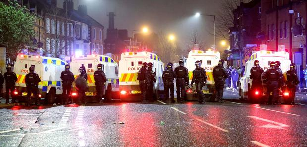 PACEMAKER, BELFAST, 7/4/2021:  PSNI riot squad officers try to keep Nationalist and Loyalists apart at Lanark Way interface in Belfast during a riot on Wednesday night. Loyalists had blocked traffic during a protest which then erupted into a riot. PICTURE BY STEPHEN DAVISON