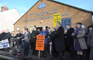 Members of the Tyndale Free Presbyterian Church hold an outdoor service near to Windsor Park in protest against Northern Ireland's first match to be played on a Sunday, before the UEFA Euro 2016 Qualifier against Finland at Windsor Park, Belfast. Presseye/Declan Roughan.
