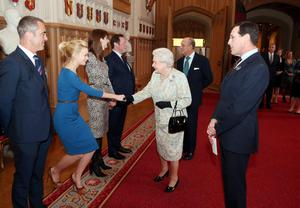 Queen Elizabeth II meets actress Carey Mulligan as actor James Nesbitt looks on at a reception for the British Film Industry at Windsor Castle