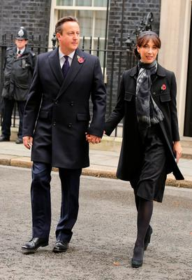 Prime Minister David Cameron and his wife Samantha walk through Downing Street on their way to the annual Remembrance Sunday service at the Cenotaph memorial in Whitehall. Chris Radburn/PA Wire.