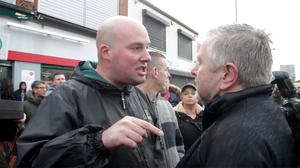 Dee Fennell confronts Fr Gary Donegan at the Ardoyne shop fronts after the Orange Order parade made it return from the twaddell protest camp. Picture Colm O'Reilly