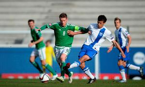 Northern Ireland's Steven Davies battles for the ball with Finland's Roman Eremenko during the UEFA Euro 2016 Qualifier at Windsor Park, Belfast. Martin Rickett/PA Wire.