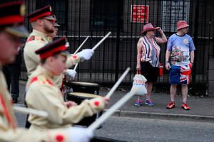 Supporters attend an Orange Order parade in  Belfast, as part of the annual Twelfth of July celebrations, marking the victory of King William III's victory over James II at the Battle of the Boyne in 1690. PRESS ASSOCIATION Photo. Picture date: Friday July 12, 2019. See PA story ULSTER Twelfth. Photo credit should read: Brian Lawless/PA Wire