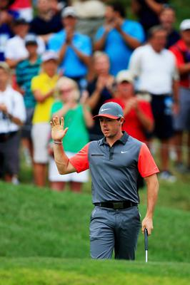 LOUISVILLE, KY - AUGUST 07:  Rory McIlroy of Northern Ireland celebrates a putt for birdie on the 14th hole during the first round of the 96th PGA Championship at Valhalla Golf Club on August 7, 2014 in Louisville, Kentucky.  (Photo by David Cannon/Getty Images)