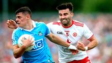 Up close: Tyrone's Tiernan McCann (right) with Brian Howard, a real find for Dublin