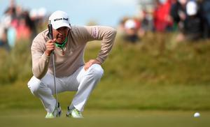 NEWCASTLE, NORTHERN IRELAND - MAY 28:  Padraig Harrington of Ireland lines up on the 18th green during the First Round of the Dubai Duty Free Irish Open Hosted by the Rory Foundation at Royal County Down Golf Club on May 28, 2015 in Newcastle, Northern Ireland.  (Photo by Ross Kinnaird/Getty Images)