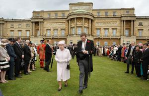 The Queen with the out-going Lord Chamberlain at a garden party in the grounds of Buckingham Palace (John Stillwell/PA)