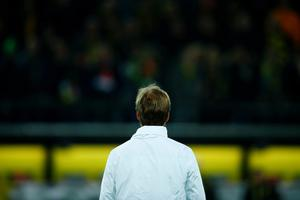 Liverpool's German head coach Jurgen Klopp follows the warm up prior to the UEFA Europe League quarter-final, first-leg football match Borussia Dortmund vs Liverpool FC in Dortmund, western Germany on April 7, 2016. / AFP PHOTO / ODD ANDERSENODD ANDERSEN/AFP/Getty Images