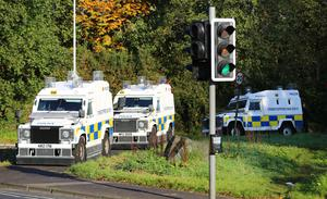 Police officers search bushes and trees in the Poleglass area of West Belfast in relation to the murder of Joe Reilly on October 24th 2016, Northern Ireland (Photo by Kevin Scott / Belfast Telegraph)