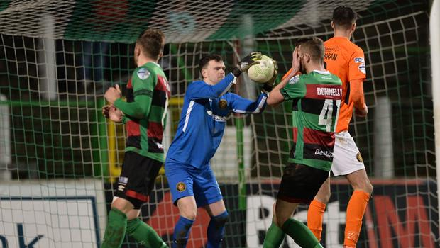 Glentoran's Rory Donnelly and Carrick's Harry Doherty. Credit: Andrew McCarroll/ Pacemaker Press