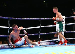 Ryan Burnett from Belfast with Anthony Settoul from France during their Vacant WBC International Bantamweight Championship contest on the undercard of the Frampton Quigg World Super-Bantamweight unification clash at the Manchester Arena.
