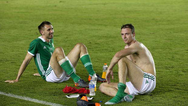 Press Eye - Belfast -  Northern Ireland - 29th May 2018 - Photo by William Cherry/Presseye  Northern Ireland's Gareth McAuley and Jonny Evans at the final whistle of Wednesday nights International Friendly against Panama at the Estadio Rommel Fernandez, Panama City.
