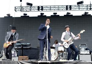 INDIO, CA - APRIL 13:  (L-R) Musicians Nalle Colt, Ty Taylor, Richard Danielson and Rick Barrio Dill of the band Vintage Trouble perform onstage during day 2 of the 2013 Coachella Valley Music & Arts Festival at the Empire Polo Club on April 13, 2013 in Indio, California.  (Photo by Kevin Winter/Getty Images for Coachella)