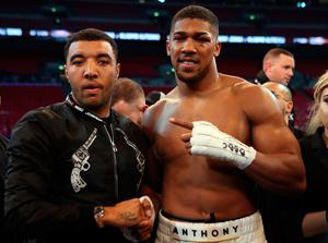 Anthony Joshua post fight Watford striker Troy Deeney following the IBF, WBA and IBO Heavyweight World Title bout against Wladimir Klitschko at Wembley Stadium, London. PRESS ASSOCIATION Photo. Picture date: Saturday April 29, 2017. See PA story BOXING London. Photo credit should read: Nick Potts/PA Wire