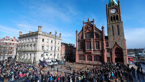 Families, relatives and supporters of those died gather outside the Guildhall in Londonderry, Northern Ireland, after the announcement from the Public Prosecution Service that one former paratrooper, soldier F is to be charged with two murders and four attempted murders during Bloody Sunday in Londonderry in 1972. PRESS ASSOCIATION Photo. Picture date: Thursday March 14, 2019. See PA story ULSTER Sunday. Photo credit should read: Niall Carson/PA Wire