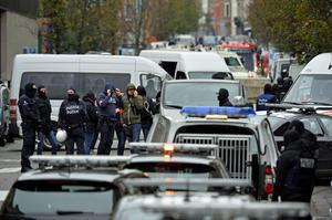 Police officers man a cordon as an operation takes place in the Molenbeek district of Brussels on November 16, 2015. Belgian police launched a major new operation in the Brussels district of Molenbeek, where several suspects in the Paris attacks had previously lived, AFP journalists said. Armed police stood in front of a police van blocking a street in the run-down area of the capital while Belgian media said officers had surrounded a house. Belgian prosecutors had no immediate comment..  AFP PHOTO / BELGA / BENOIT DOPPAGNEBENOIT DOPPAGNE/AFP/Getty Images