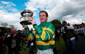 Tony McCoy parades the Champion Jockey Trophy during the bet365 Jump Finale at Sandown Racecourse, Surrey David Davies/PA Wire