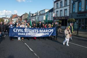 The Civil Rights March marking the 1968 march passes the point in Duke Street in Derry's Waterside where it was stopped fifty years ago. Picture Martin McKeown. Inpresspics.com. 06.10.18