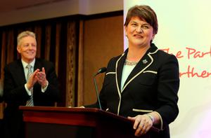 Former DUP leader Peter Robinson (L) claps as the new leader Arlene Foster, Northern Ireland Finance Minister in Belfast speaks after the election contest for leader of the Democratic Unionist Party (DUP) on December 17, 2015. A special electoral college will gather at the hotel, and Foster is the only candidate for the leadership. Foster will replace Peter Robinson following his announcement that he will step down as Northern Ireland's First Minister and as leader of the DUP.  AFP PHOTO / PAUL FAITHPAUL FAITH/AFP/Getty Images