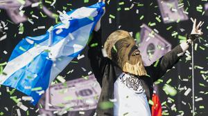 Lewis Capaldi on the TRNSMT main stage wearing a Chewbacca mask (Lesley Martin/PA)