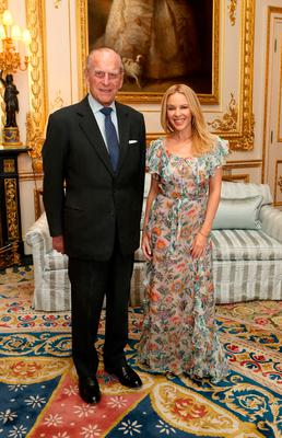 File photo dated 04/04/17 of Kylie Minogue with the Duke of Edinburgh, who will no longer carry out public engagements from the autumn of this year, Buckingham Palace has announced. PRESS ASSOCIATION Photo. Issue date: Thursday May 4, 2017. See PA story ROYAL Duke. Photo credit should read: Steve Parsons/PA Wire