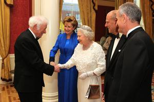Queen Elizabeth II shakes hands with Irish poet, Seamus Heaney as Irish President Mary McAleese, Prince Philip, Duke of Edinburgh and Dr. Martin McAleese look on before a State Dinner at Dublin Castle, on May 18, 2011 in Dublin