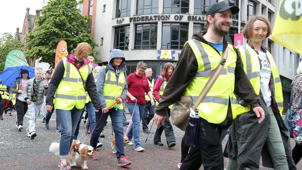 Press Eye - Belfast - Northern Ireland - 25th May 2019  A walk in memory of murdered journalist Lyra McKee begins from Belfast this morning and will finish in Derry on Monday.  Around 400 people set off from WriterÕs Square for the walk to Derry in memory of the 29-year-old, who was killed last month as she observed rioting in Derry.  The three-day hike will conclude in the Guildhall Square in Derry on Monday, by which time the number of walkers is expected to have swelled to around 700. The event will culminate in a two-hour concert, including a performance by Snow Patrol frontman Gary Lightbody. LyraÕs sister Nicola will also address those assembled.  Picture by Jonathan Porter/PressEye