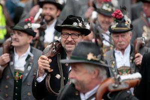 MUNICH, GERMANY - OCTOBER 05:  Bavarian riflemen of the Munich Salute Gun Regiment (Muenchner Boellerregiment) arrive for the firing of their traditional salute with one-shot guns on the steps under the Bavaria statue on the last day of the 2014 Oktoberfest on October 5, 2014 in Munich, Germany. The 181st Oktoberfest is coming to an end today an drew millions of visitors from across the globe in the world's largest beer fest.  (Photo by Johannes Simon/Getty Images)