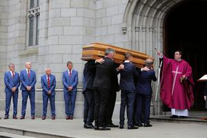 Friends and Realtives carry the coffin of Newry Businessman Brian Conlon as it arrives for funeral mass at  St Patrick and St Colman's Cathedral, Newry (Photo by Paul McErlane for the Belfast Telegraph)
