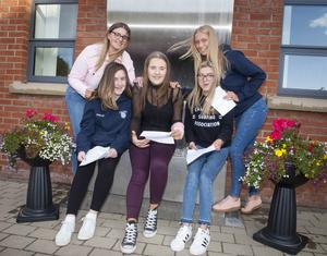 CHECKING RESULTS. . . .St Mary's College, Derry students Mairead Ward, Chloe Boyle, Oliwia Marcinkowska, Niamh Dunlop and Emma Doherty discuss their results yesterday morning.