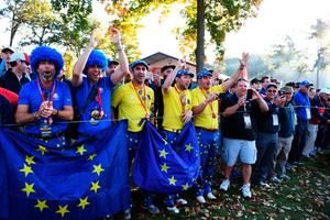 CHASKA, MN - OCTOBER 01: European fans cheer along the course during morning foursome matches of the 2016 Ryder Cup at Hazeltine National Golf Club on October 1, 2016 in Chaska, Minnesota.  (Photo by Ross Kinnaird/Getty Images)