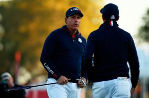 CHASKA, MN - OCTOBER 01: Phil Mickelson and Rickie Fowler of the United States look on from the first green during morning foursome matches of the 2016 Ryder Cup at Hazeltine National Golf Club on October 1, 2016 in Chaska, Minnesota.  (Photo by Ross Kinnaird/Getty Images)
