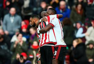 SUNDERLAND, ENGLAND - FEBRUARY 13:  Lamine Kone (R) of Sunderland celerbates his team's second goal with his team mates during the Barclays Premier League match between Sunderland and Manchester United at the Stadium of Light on February 13, 2016 in Sunderland, England.  (Photo by Clive Brunskill/Getty Images)