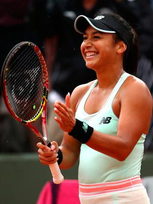 All smiles: Heather Watson after her win over Oceane Dodin yesterday