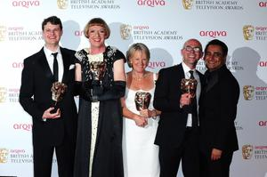 Grayson Perry (second left) with the winners for Best Specialist Factual Programme Award for All in the Best Possible Taste at the 2013 Arqiva British Academy Television Awards at the Royal Festival Hall, London. PRESS ASSOCIATION Photo. Picture date: Sunday May 12, 2013. See PA story SHOWBIZ Bafta. Photo credit should read: Ian West/PA Wire